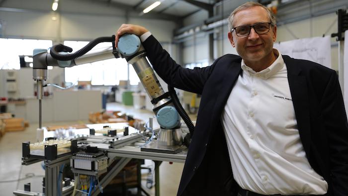 Jürgen von Hollen, president of Universal Robots, delivered the company's 50,000th cobot.